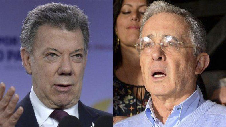 El presidente y el exmandatario colombianos nombraron a tres negociadores.