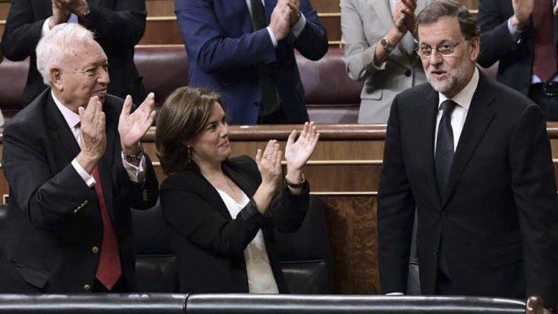 Rajoy se mostró contento por su investidura y dijo que hay mucha tarea por hacer.