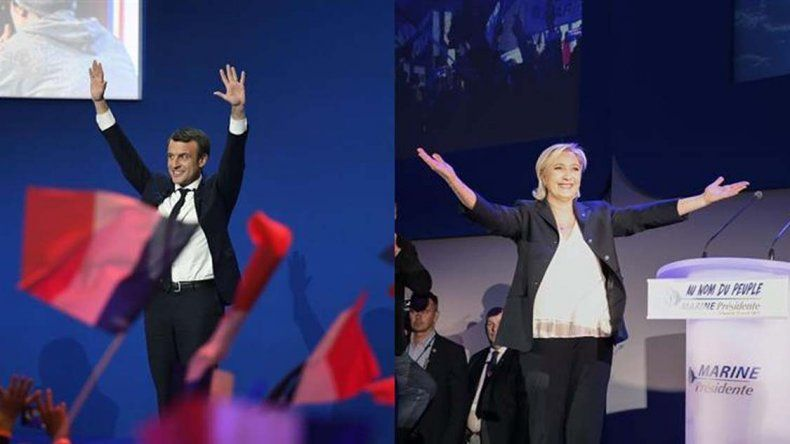 El economista Emmanuel Macron y la candidata del Frente Nacional Marine Le Pen festejan ante sus votantes.
