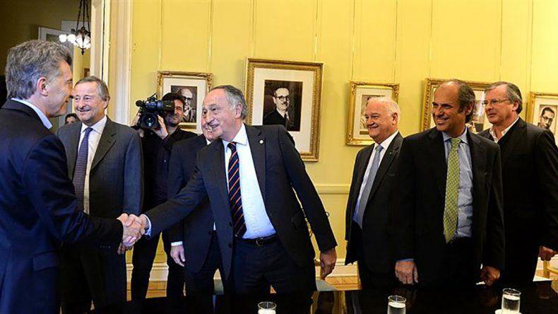 Macri saludando a Miguel Acevedo