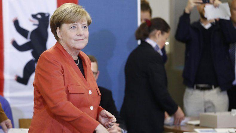 Angela Merkel al emitir ayer su voto.