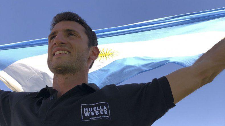 Germán y la bandera argentina. Premiaron mi trayectoria y seguramente también que me haya levantado de un mal momento