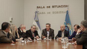 La reunión en Casa de Gobierno fue con diputados y autoridades del Banco Chubut.