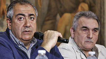 Héctor Daer y Juan Carlos Schmid, quienes junto a Carlos Acuña integran el triunvirato que lidera la CGT.