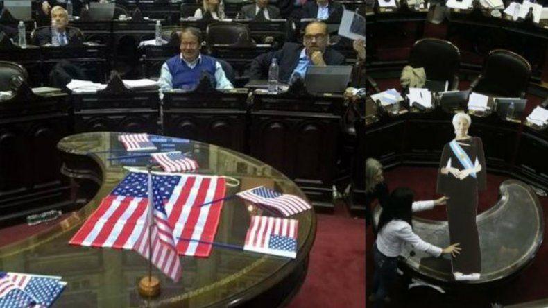 Banderas de EEUU y una figura de Lagarde en la sesión del Congreso