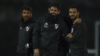 Leonardo Ponzio, Germán Lux e Ignacio Scocco durante el entrenamiento ayer de River en Madrid.