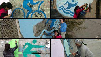 Muralistas embellecieron el edificio de la Escuela N° 797